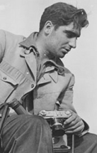 Magnum Photographer Robert Capa with his Leica Camera
